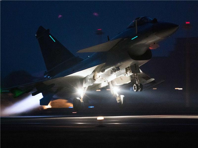 J-10 fighter jets take off at night