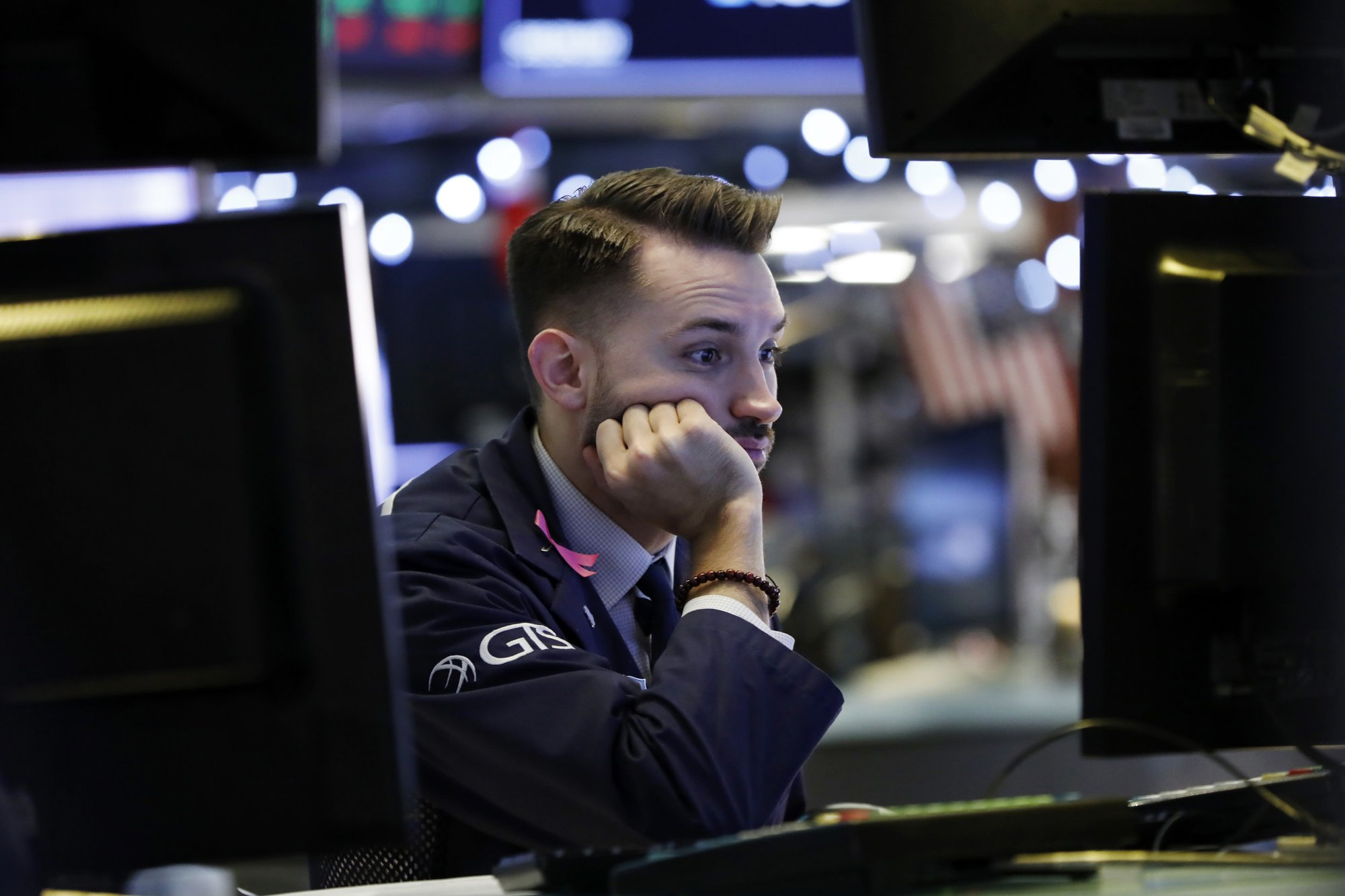 US stocks head sharply lower a day after Dow's record gain