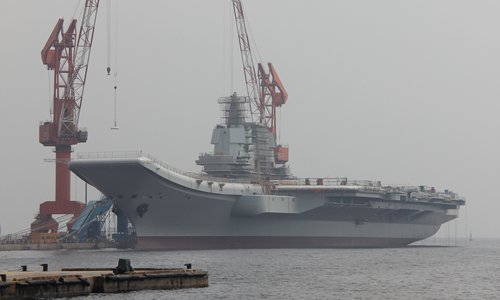 China's second aircraft carrier may be undergoing fourth sea trial including J-15 jet fighter test