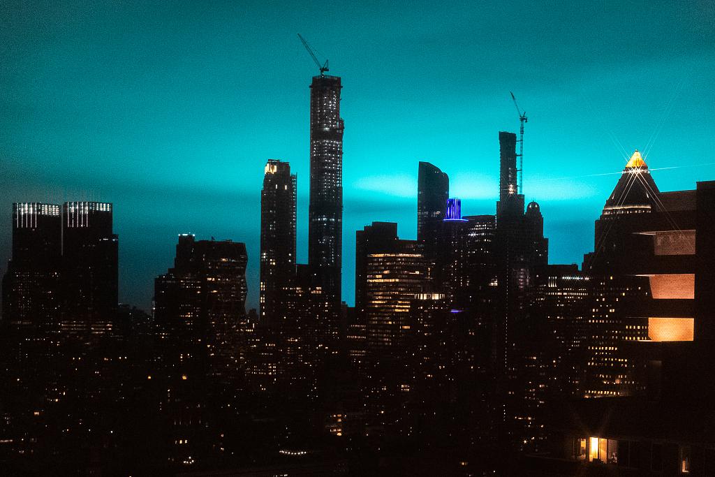 Blue light illuminates night sky as transformer explodes in New York