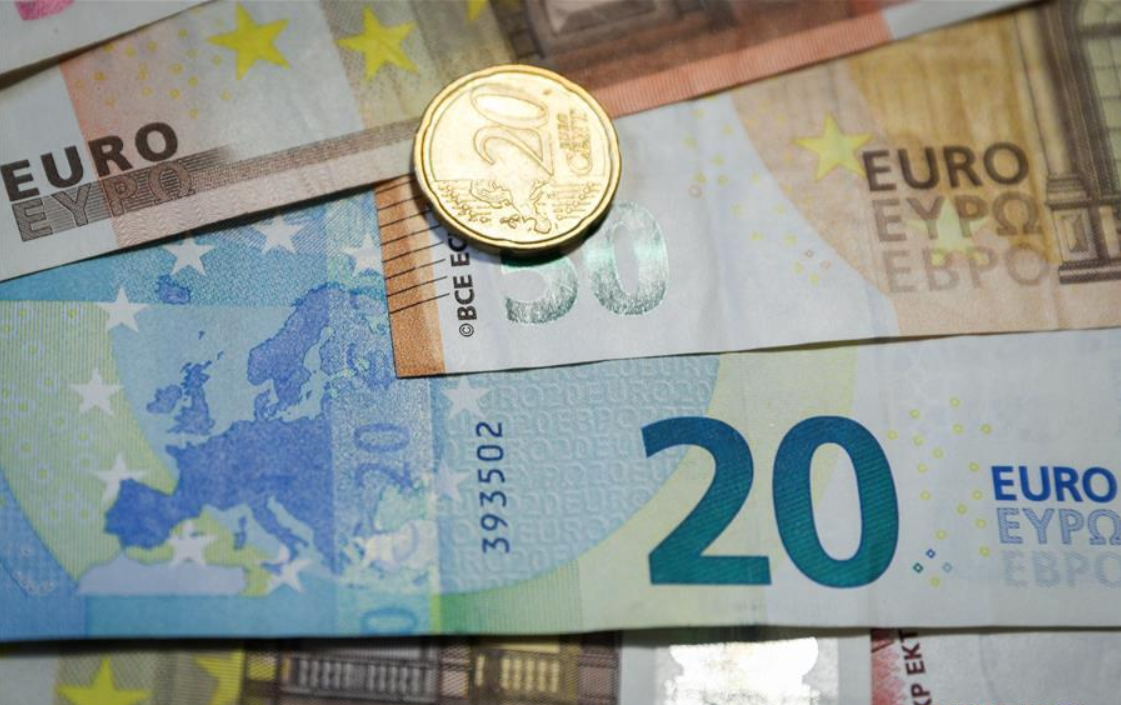 EU leaders tout euro's success on eve of 20th anniversary