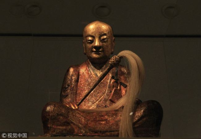 The Zhanggong Zushi Buddha statue at an exhibition in Hungary in March 2015. [File photo: VCG]