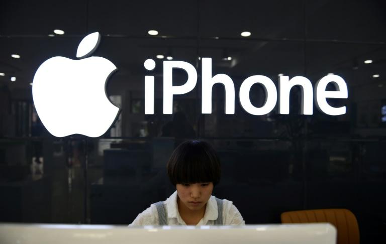 US stocks tumble on Apple, manufacturing data