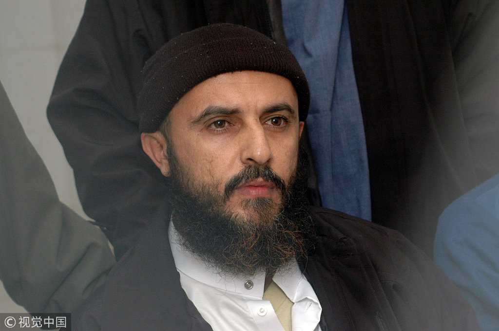 Yemeni convict Jamal al-Badawi listens to the verdict being announced from behind the bars in a Sanaa appeals court, February 26, 2005. [File photo: VCG]