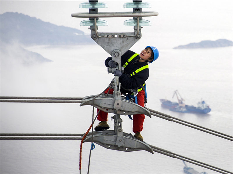 Electricians check world's tallest transmission towers before trial operation