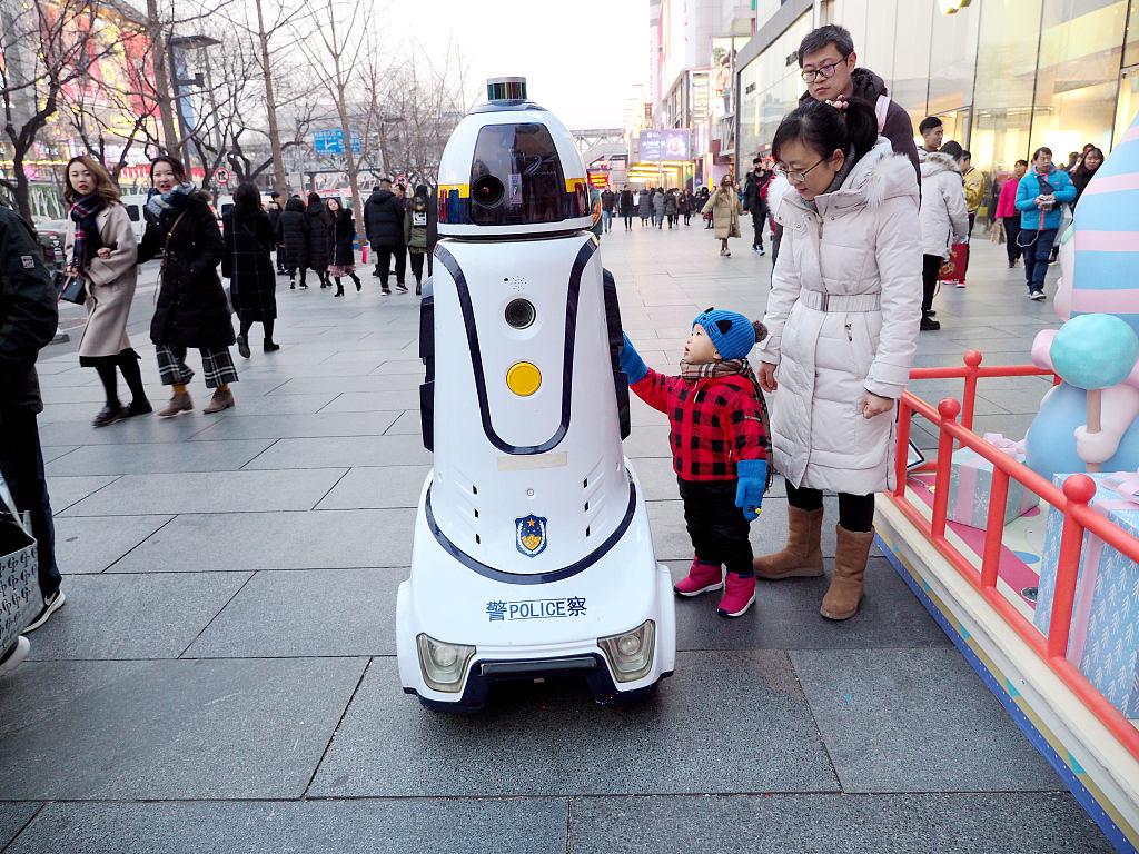 Robot police patrol Xidan business zone in Beijing