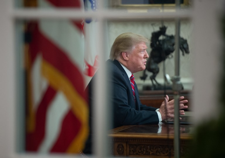 Trump goes on TV to defend border wall plan