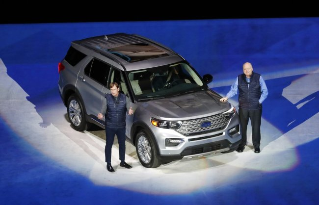 Ford Motor Co., President, Global Markets Jim Farley, left, and President and CEO Jim Hackett stand next to the redesigned 2020 Ford Explorer during its unveiling, Wednesday, Jan. 9, 2019, in Detroit. [Photo: AP]