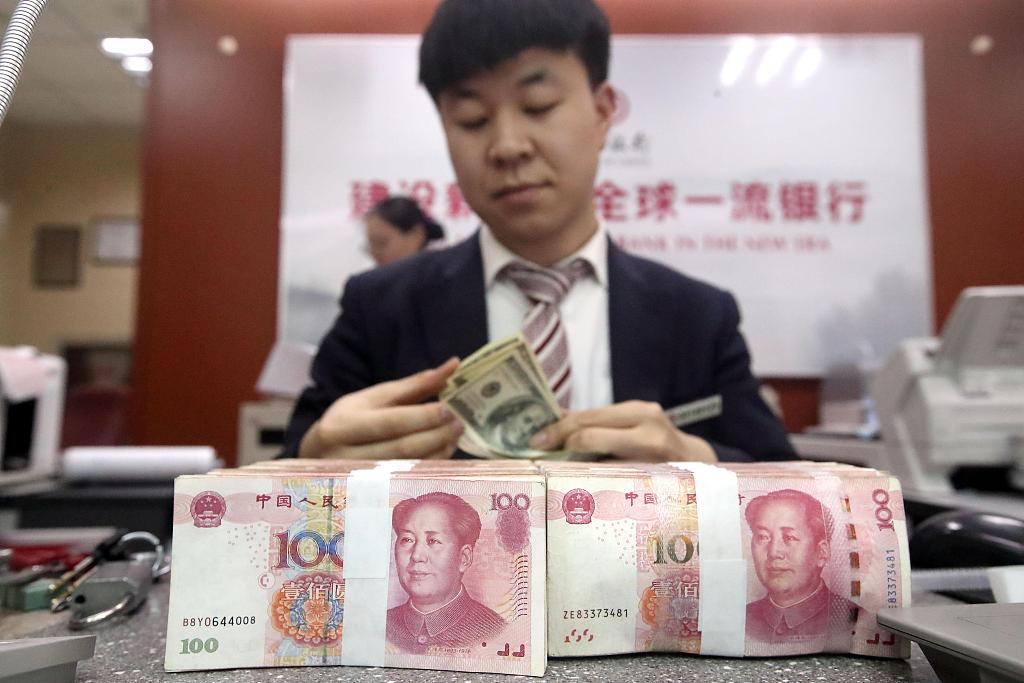 Yuan hits 5-month peak vs US dollar