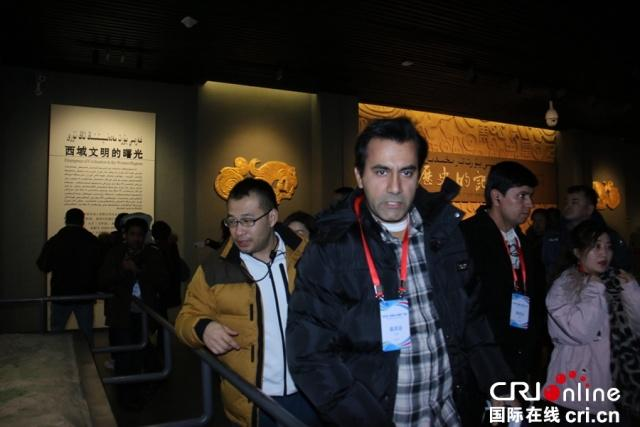 """Journalists visit the Xinjiang Museum on January 9, 2019, as part of the seventh """"Silk Road Celebrity Tour"""". [Photo: China Plus]"""