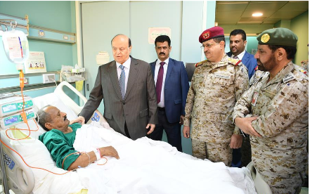 Yemen's president visits officials injured by Houthi drone strike