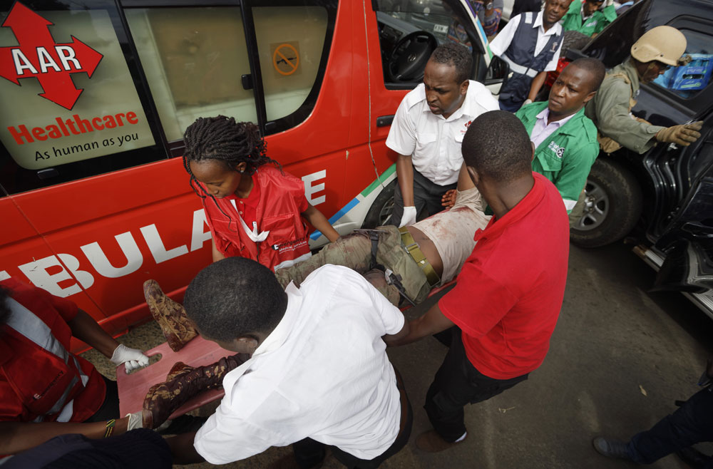 A wounded member of Kenyan special forces with two tourniquets around his legs is carried from a US embassy diplomatic vehicle into an ambulance by paramedics at the scene Wednesday, Jan. 16, 2019 in Nairobi, Kenya. Extremists stormed a luxury hotel in Kenya's capital on Tuesday, setting off thunderous explosions and gunning down people at cafe tables in an attack claimed by Africa's deadliest Islamic militant group. [Photo: AP/Ben Curtis]