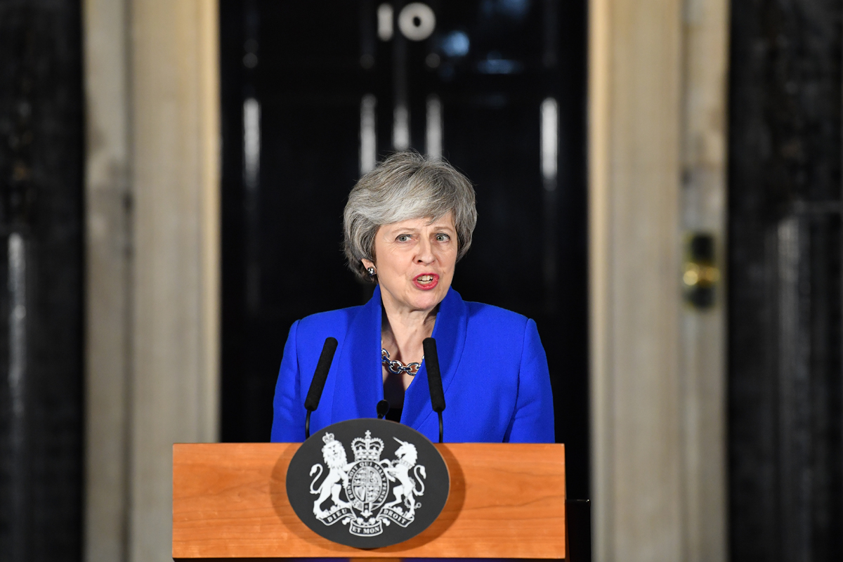 Britain's Prime Minister Theresa May delivers a speech to members of the media in Downing Street in London on January 16, 2019, after surviving a vote of no confidence in her government. British Prime Minister Theresa May's government saw off a vote of no confidence in parliament on Wednesday, called after MPs overwhelmingly rejected the Brexit deal.[Photo: AFP/Ben STANSALL]