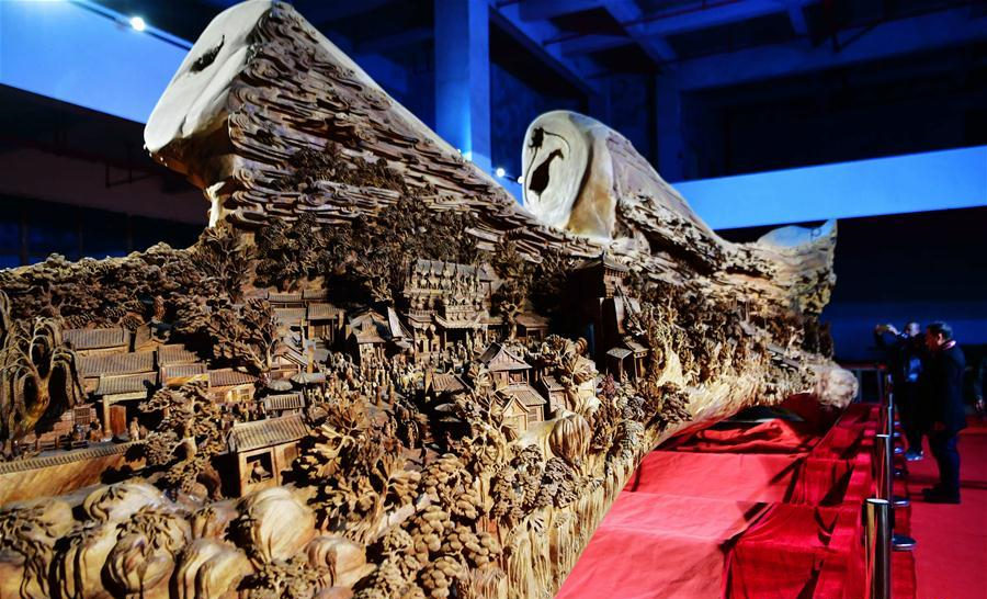 Giant camphor wood carving of ancient painting