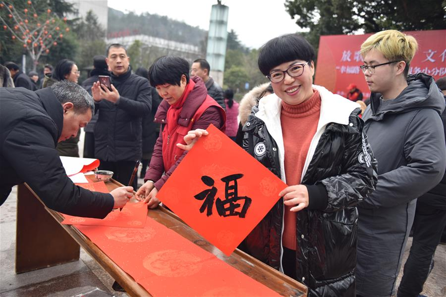 """Calligraphers write Chinese character """"fu"""", Spring Festival couplets in Hangzhou"""