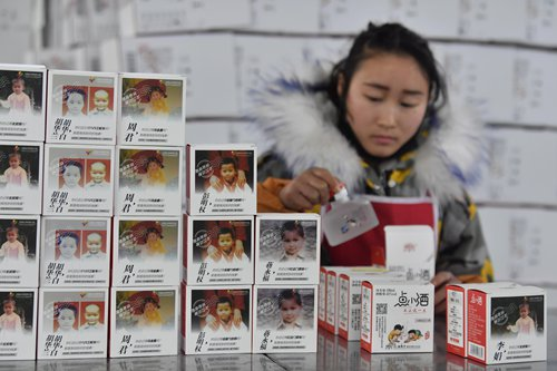 In fight against child trafficking, China puts missing kids info on liquor bottles, takeout boxes