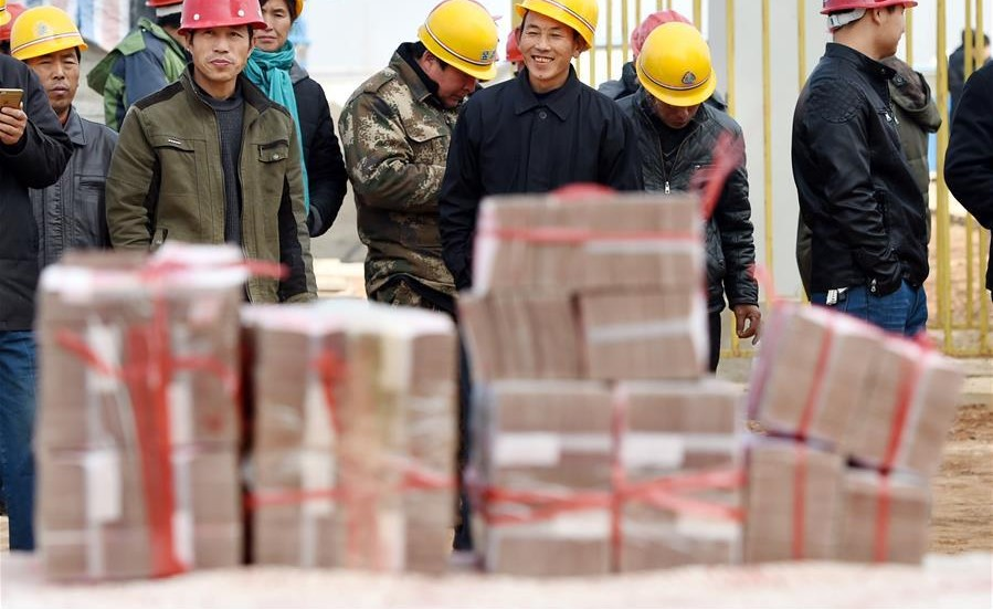Migrant workers paid 5.7 billion yuan in owed wages