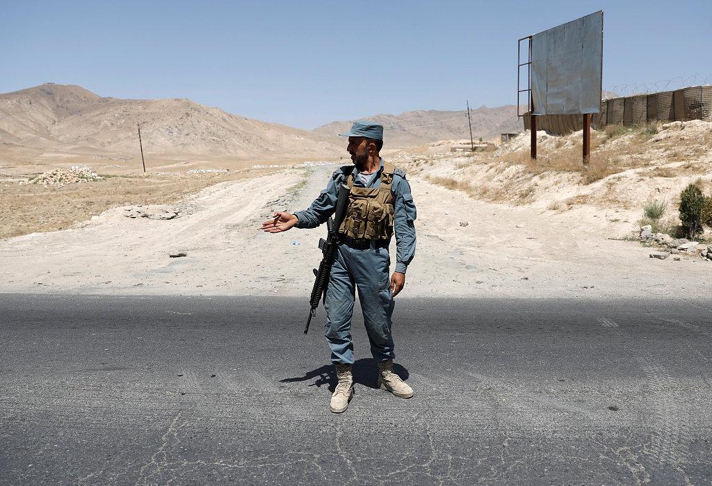 Taliban target military base, police center, killing 12