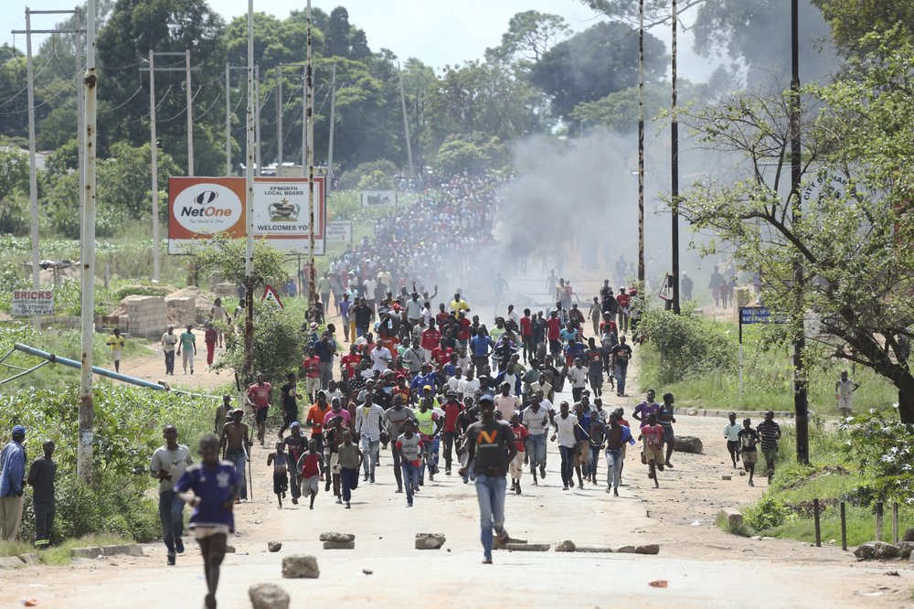 Zimbabwe's crackdown continues with arrest of labor leader