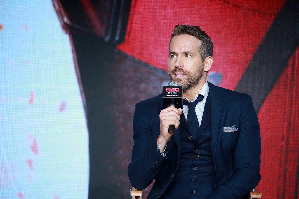 Ryan Reynolds cancels arm surgery to promote 'Once Upon a Deadpool' in China