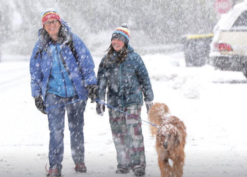 Blowing snow in Colorado closes schools, highway stretches