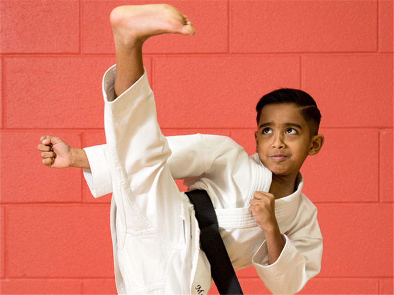 Eight-year-old British boy becomes world's youngest black belt