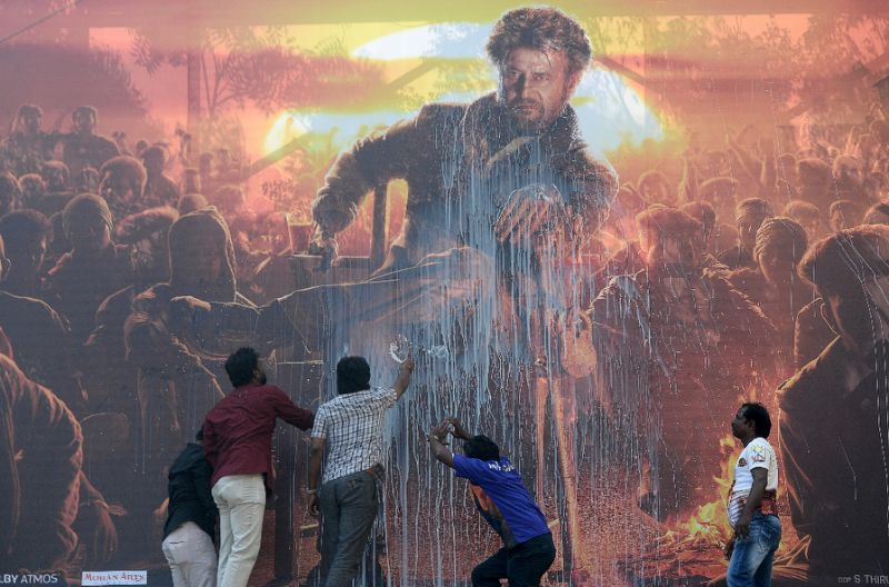 Splashing out: Indian fans steal milk for movie poster antics