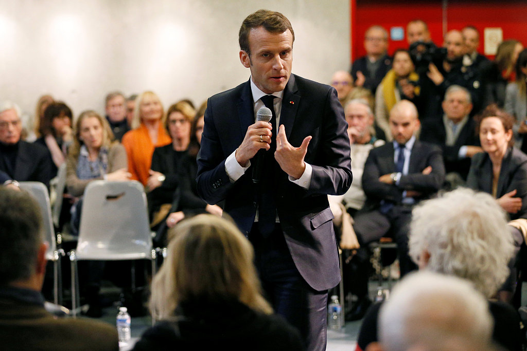 Macron popularity up after campaign-style public performances
