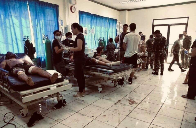 Death toll in southern Philippines explosions climbs to 19