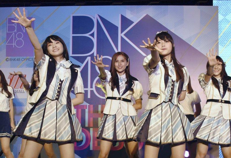 Singer in Thai girl band apologizes for swastika shirt