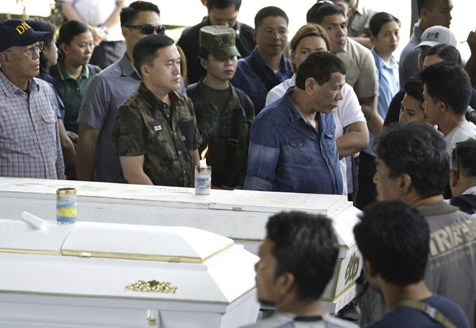 Duterte visits site of fatal bombings, Abu Sayyaf suspected