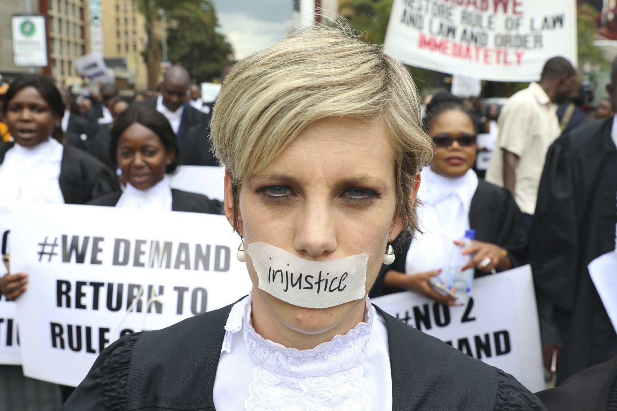 Lawyers march in Zimbabwe capital alleging denial of justice
