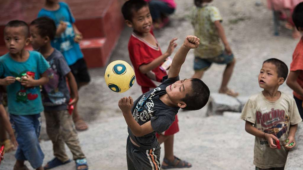 For 'left-behind children,' China plans to plug policy gaps