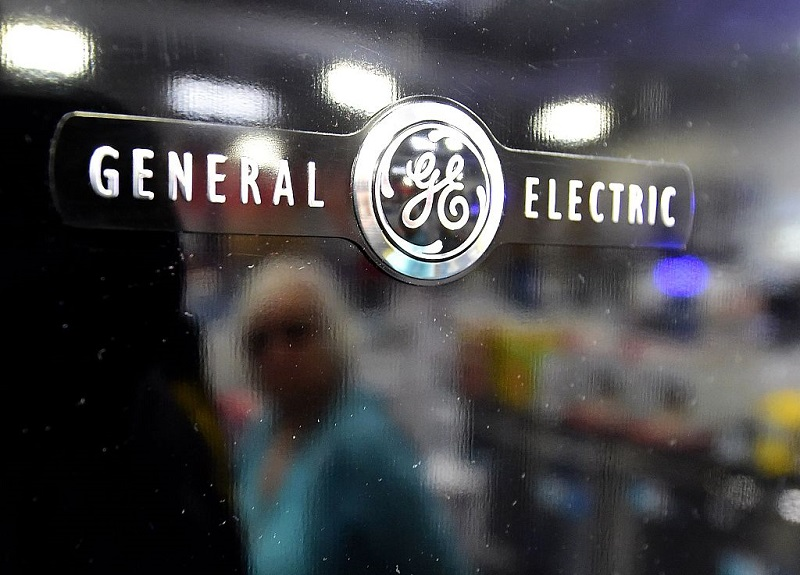 GE reports 4Q profits, sees US settlement on mortgages