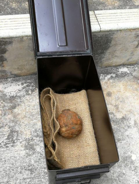 A World War I-era hand grenade is found in a shipment of potatoes from France on February 2, 2019. [Screenshot: China Plus]