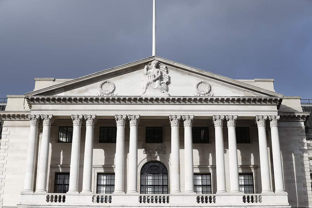 Bank of England holds interest rate unchanged, cuts growth forecast