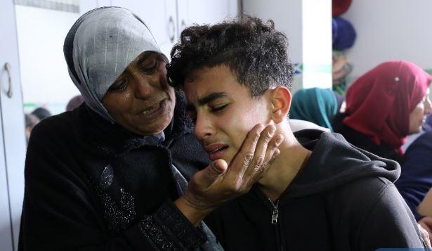 Outraged Palestinian mourners bury 2 teens killed by Israeli gunfire near Gaza's border