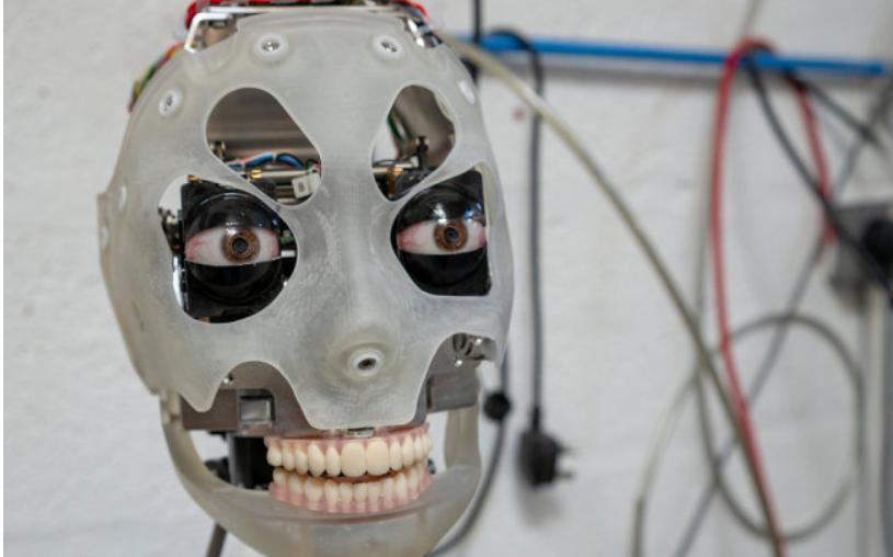 British AI robot draws human portraits