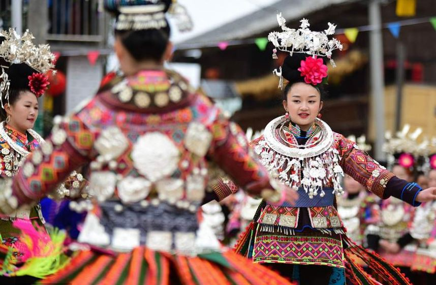 Miao people perform folk dance to celebrate Lunar New Year