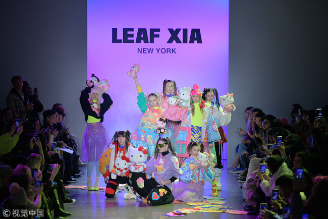 Models pose for the Leaf Xia FW19 runway show in Gallery II of Spring Studios during New York Fashion Week: The Shows at Spring Studios on February 13, 2019 in New York City.[Photo via IC/Roy Rochlin]