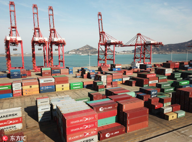 Stacks of containers to be shipped abroad at Lianyungang Port in Jiangsu Province. [Photo: IC]