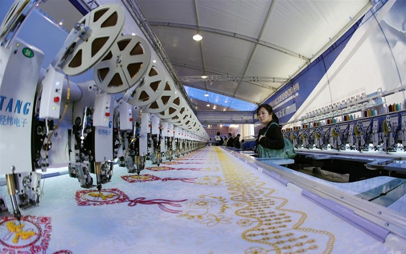 Through industrial upgrading, China's textile hub spins success story