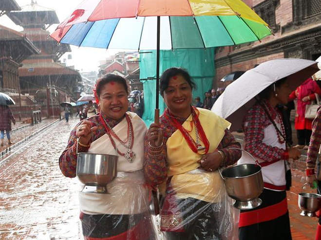 Women participate in Bhimsen Puja celebration in Lalitpur, Nepal