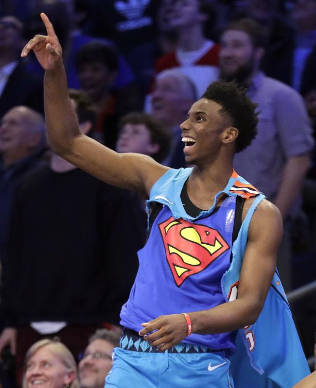 Oklahoma City Thunder Hamidou Diallo reacts to his dunk during the NBA All-Star Slam Dunk contest, Saturday, Feb. 16, 2019, in Charlotte, N.C. Diallo won the contest. [Photo: AP/Chuck Burton]