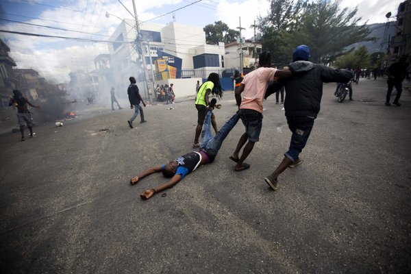 Haitians seek water, food as businesses reopen after protest