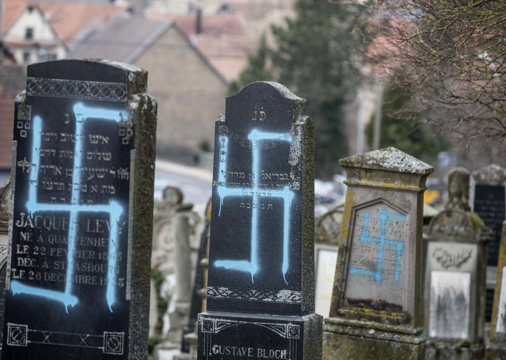 French rally against anti-Semitism; Macron visits cemetery