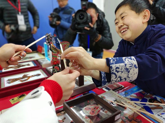 Traditional handicrafts displayed at Beijing Spring Festival temple fair