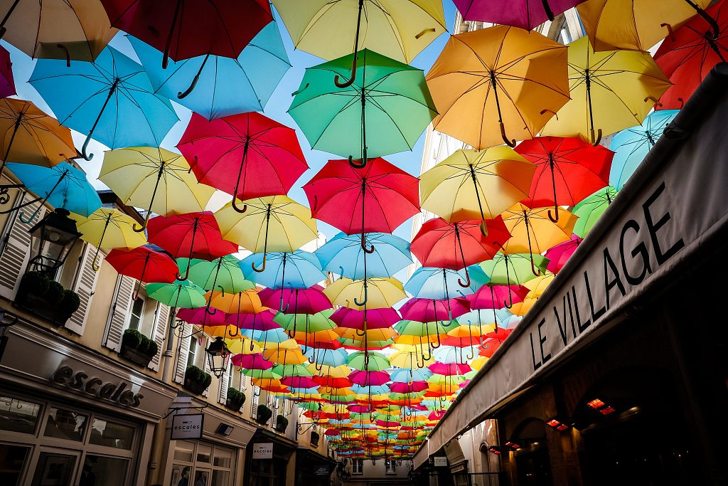Sky of colorful umbrellas installed at the Royal Village in Paris