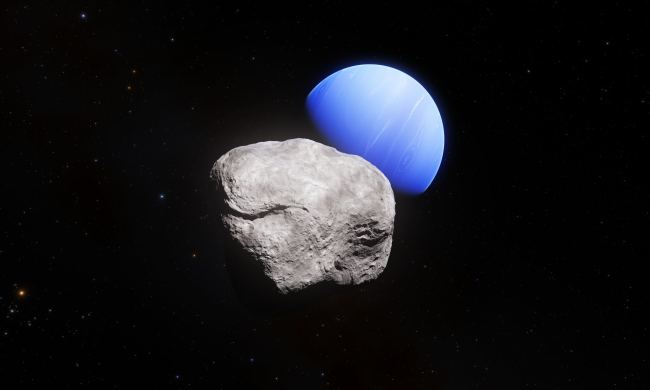 A handout released on February 20, 2019 shows an artist's impression of the outermost planet of the Solar System, Neptune, and its small moon Hippocamp. Hippocamp was discovered in images taken with the NASA/ESA Hubble Space Telescope. Whilst the images taken with Hubble allowed astronomers to discover the moon and also to measure its diameter, about 34 kilometres, these images do not allow us to see surface structures. [Photo: AFP]