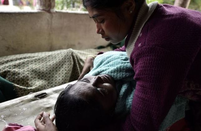Death toll in India's hooch tragedy rises to 104